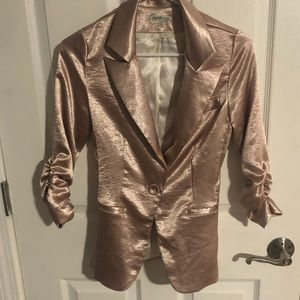 Light pink shimmer sport coat.